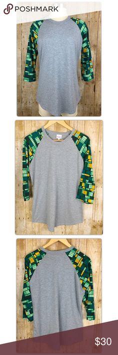 Selling this LuLaRoe Randy Tee Grey with Green Geometric Sleeve on Poshmark! My username is: doyoueventhrift. #shopmycloset #poshmark #fashion #shopping #style #forsale #LuLaRoe #Tops