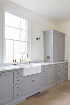 The modern scullery at the Georgian hunting lodge project with Nickleby cabinetry painted in Farthing and aged brass hardware. Georgian Interiors, Kitchen Remodel, Kitchen Decor, Cabinetry, Kitchen Taps, House Inside, English Kitchens Design, Humphrey Munson, Kitchen Design