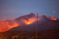 A view of the Dean Peak Fire on Tuesday from the base of the mountains. Arizona News
