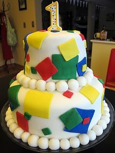 attempt at a fondant cake, easy to decorate with overlapping squares from fondant cutters and Wilton's primary color fondant pack Easy Fondant Decorations, Birthday Ideas, Birthday Cake, Square Cakes, Fondant Cakes, Beverage, Squares, First Birthdays, Chloe