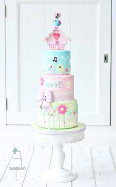 Cake in pastels with birdcage / Taart in pastel tinten met vogelhuisje