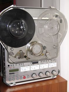 "Nagra D  + ND-SET-2 ( 7"" Lid ) . The Nagra D was introduced in 1992, and still used 1/4"" tape albeit digital ( video) tape."
