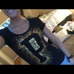 VSPINK Gold & Black BLING Tee!! this tee is absolutely gorgeous. worn only a few times. no flaws, great condition!! the sequins are just gorgeous. Feel free to make me a reasonable offer using the offer button!  PINK Victoria's Secret Tops Tees - Short Sleeve