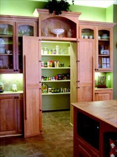 Hidden walk-in pantry - This extra large walk-in pantry is accessed directly from the kitchen behind what appear to be broom closet or cabinet pantry doors. Very simple, easy to recreate, and provides you with a giant pantry you can use for decades.
