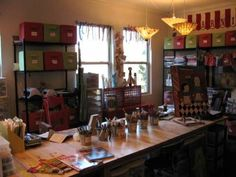 Dining room converted to craft room. I don't care enough about craft but I love the idea.