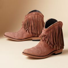 Short and sassy boots, deeply fringed below a curvy topline, are the fresh and flirty western choice. Distressed leather, leather sole and chunky heel. Imported. Whole and half sizes 6 to 10, 11.