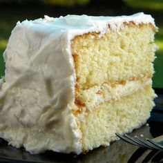1 pkg yellow cake mix, 1 and1/4 cup heavy cream, 3 large eggs, 1/4 cup melted butter.  350 degrees 30-35 min   The BEST cake you'll ever make!!!