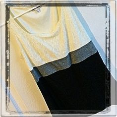 Classy, sheik Express Tank Gorgeous Express tank. Cream, grey and black. Empire waste. The cream section has a lace overlay. You can keep it casual with jeans or wear at the office with slacks and a cardi or with a pencil line skirt. Worn less than a handful of times. EUC just a little too small for me. True to size. Express Tops Tank Tops