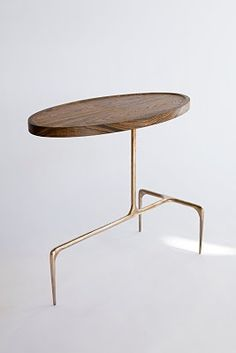 """BRIDGER OVAL OCCASIONAL TABLE, WOOD TOP.  19"""" long x 10"""" wide x 16.5"""" high (48 x 25.5 x 42 cm)steel or bronze base with wood top; please specify hand-carved wood tops available only in CASTE Studio finish options.  Carried by Holly Hunt."""