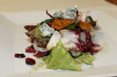 Thanksgiving dinner: Peer salad with cranberries, almonds, blue cheese and a dill vinaigrette.