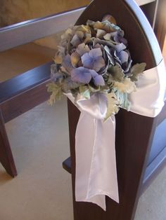 Blue Hydrangeas pew ends, but with lace ribbons