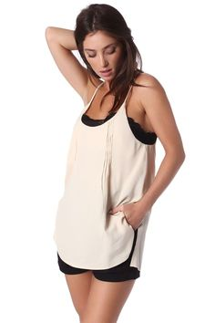 Beige round neck top with eyelash lace detail in black