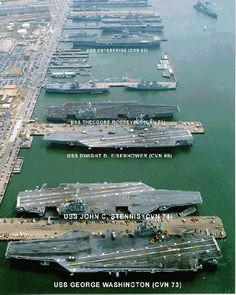 Norfolk Naval Base, Norfolk, VA. It is uncommon for this many Nuclear Aircraft Carriers (5) to all be in port at one time. The USS JOHN C. STENNIS (CVN-74), returned to port on July 2, 1997, joining the USS GEORGE WASHINGTON (CVN-73), USS THEODORE ROOSEVELT (CVN-71), USS ENTERPRISE (CVN-65) and the USS DWIGHT D. EISENHOWER (CVN-69).