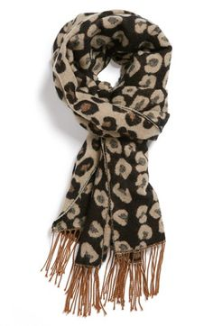 A soft knit shapes this reversible fringe scarf speckled with a chic feline print. animal print!