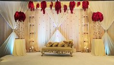 Yanni Design Studio created a beautiful bridal stage with hints of red fresh floral for an Indian Reception Indian Wedding Stage, Indian Reception, Wedding Reception Backdrop, Wedding Stage Decorations, Engagement Decorations, Mehndi Stage, Beaded Curtains, Budget Wedding, Wedding Ideas