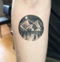 Mountains with road threw forest, circle tattoo