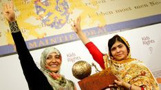 When activist and Nobel Prize laureate Malālah Yūsafzay received the International Children's Peace Prize from Yemeni journalist and human rights activist Tawakkul Karmān in both women formed (what is considered as) the peace sign and the Rābiʿa sign. Body Gestures, Dutch Language, Human Rights Watch, Catholic University, Human Rights Activists, Malala Yousafzai, Islamic Studies, Muslim Brotherhood, National Symbols
