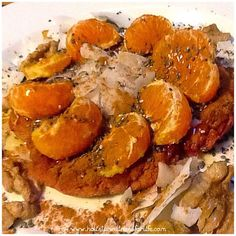 Beautiful beetroot and flaked almond pancake topped with fresh mandarin, coconut flakes, chia seeds, cinnamon, activated walnuts and raw honey. #beautiful #pancake #glutenfree #dairyfree #jerf #paleo #breakfast #healthy #fit #wellness #weightloss #foodasm