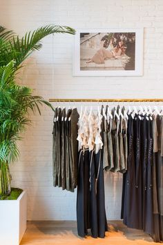 Retail space with a floating rack, a framed photograph, and bamboo