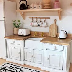 Perfect for your modern farmhouse kitchen is this white and wood unit.White cupboards and drawers (they all really open)Wooden bench top with gold look taps. Ikea Dollhouse, Modern Dollhouse Furniture, Diy Barbie Furniture, Wooden Dollhouse, Miniature Furniture, Diy Furniture, Haunted Dollhouse, Farmhouse Furniture, Dollhouse Kits