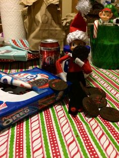 Elf on the Shelf Eating insides out of Oreos