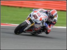 Jonathan Rea laying a darkie at Silverstone, note the compression of the rear tyre!