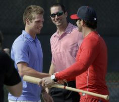 St. Louis Cardinals pitchers Shelby Miller, left, and Adam Wainwright, center, greet manager Mike Matheny after arriving at the Cardinals' spring training baseball practice facility Wednesday, Feb. 12, 2014, in Jupiter, Fla. Cardinals pitchers and catchers first official practice is scheduled for Thursday. (AP Photo/Jeff Roberson)