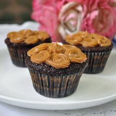 Moist chocolate cupcakes topped and filled with homemade Dulce de Leche. A match made in dessert heaven!
