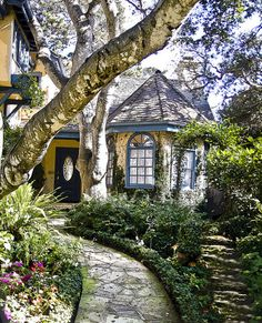 I love the walkway to this cute house.