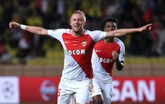 Kamil Glik (C) of AS Monaco FC celebrates after scoring the equalizer goal during the UEFA Champions League Group E match between AS Monaco FC and Bayer 04 Leverkusen at Louis II Stadium on September 27, 2016 in Monte Carlo, Monaco.