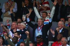 He's done it: Beckham and Johnson celebrate as Farah crosses the line