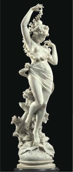 AN ITALIAN WHITE MARBLE FIGURE EMBLEMATIC OF SPRING ('LA PRIMAVERA') (137,5 cm) BY FERDINANDO ANDREINI, FLORENCE, LATE 19TH CENTURY
