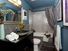 Modern bathroom design with blue painted walls and black granite sink Property Brothers, Contemporary Bathrooms, Modern Bathroom Design, Bathroom Designs, Contemporary Design, Black Granite Sink, Black Sink, Blue Painted Walls, Blue Walls