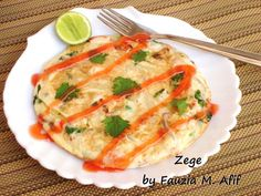 Zege- This excellent pizza-like omelette is a speciality from Tanzania. It makes for an excellent quick-fix meal for brunch or a light lunch/dinner. Made with eggs, fries and any additional ingredients like leftover chunks of cooked chicken, chopped cooked sausages, cheese, chillies, onions etc, this is one very versatile recipe!