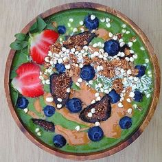Green Smoothie Bowl Full of Delicious Fruits! The yoga pose of today is: Dhanurasana (don-your-AHS-anna) dhanu = bow (Bow Pose) This pose is so called because it looks like an archers bow the torso and legs representing the body of the bow and the arms the string. Have a great day!  By @zestmylemon  Frozen Banana Spinach Almond Milk topped off with Creamy Peanut Butter Black Mission Figs Coconut Blueberries Strawberries Ancient Grain Granola and Puffs Cereal!   Tag someone you would share…