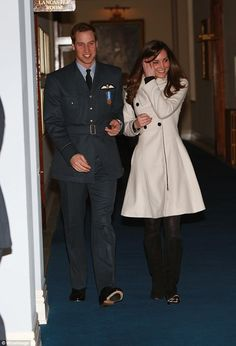 Early days: In contrast, Kate Middleton favoured demure looks for her first few outings with then boyfriend Prince William. Pictured, Kate wears an off-white coat, black tights and black heeled pumps as she attends William's graduation ceremony from RAF Cranwell in 2008