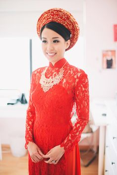 The bride wears a beautiful red Ao Dai