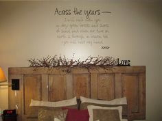 We found this old door out in our barn, it makes the perfect headboard. Love our wall saying too.