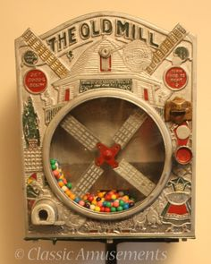 Old Mill gum-ball vending machine from USA. Operates on 1c coin with original pipe stand.