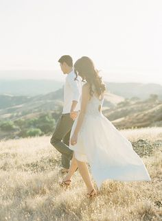 A floaty dress can look gorgeous from the right angles. Play up an asymmetrical hemline with a shot of you and your fiancé walking. Source: KT Merry via Style Me Pretty