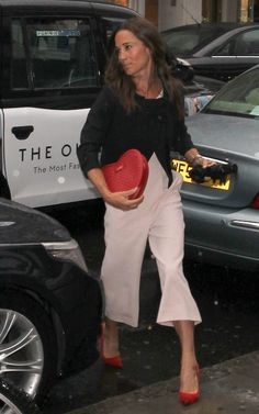 At the The Miles Frost Fund Party, Pippa showcased her penchant for literal dressing (the party was raising money for the British Heart Foundation) carrying a heart shaped clutch with tailored trousers and a black jacket.