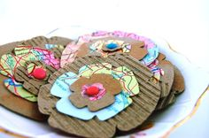 World map paper and corrugated cardboard to make flower heads.