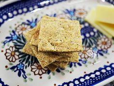 Low Carb Flax Crackers/Pizza Crust - ground/milled flax seeds, coconut flour, grated/shredded Parmesan cheese, eggs, water, herbs (she used basil, oregano, & rosemary, & recommends garlic), salt, pepper
