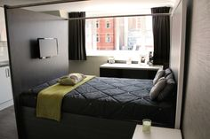 Double bed complete with mounted TV and hidden wiring for student accommodation in London