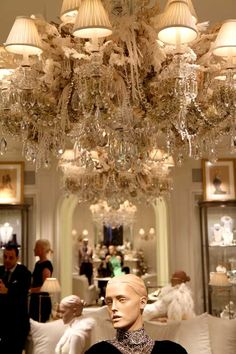 LIghting at Ralph Lauren: crystal chandelier adding pearls, lace, ribbons - oh my how luxe