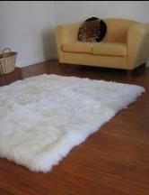 Sheepskin rug in front of fire in living room = cozy and chic.