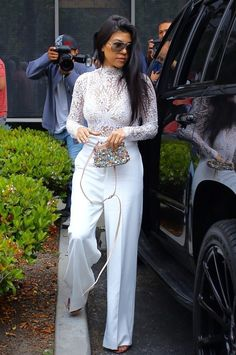Kourtney Kardashian Bodysuit - Kourtney Kardashian went to church on Easter rocking a white lace bodysuit by Misha Collection.