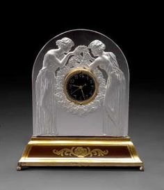 A René Lalique frosted glass table clock: Deux Figurines Marcilhac 726, model introduced 1926.
