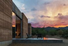 Tuscon+Mountain+Retreat+-+Exterior/Outdoor+Area: The+Tuscon+Mountain+Retreat+is+a+beautiful+home+in+the+Sonoran+Desert+that+uses+rammed+earth+composed+of+the+local+soil+beautifully+as+a+building+material.+The+minimal+impact+construction+and+the+passive+solar+design+of+this+home+makes+it...