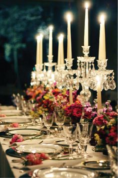 Dinner table set with romantic candles, elegant table settings, vibrant boutique of flowers. Elegant Table Settings, Beautiful Table Settings, Chandelier Design, Purple Home, Festa Party, Deco Table, Decoration Table, Dinner Table Decorations, Event Decor